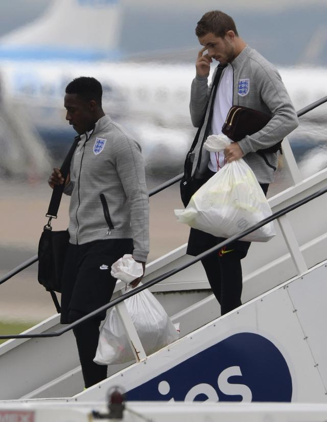 England's Jordan Henderson (R) and Danny Welbeck arrive back from the 2014 World Cup in Brazil at Manchester airport, northern England June 25, 2014. REUTERS/Nigel Roddis (BRITAIN - Tags: SPORT SOCCER WORLD CUP)