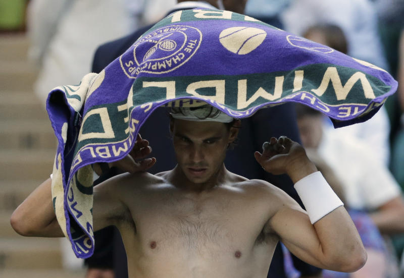 Rafael Nadal of Spain dries himself off after he lost the third set to Lukas Rosol of the Czech Republic during a second round men's singles match at the All England Lawn Tennis Championships at Wimbledon, England, Thursday, June 28, 2012. (AP Photo/Anja Niedringhaus)