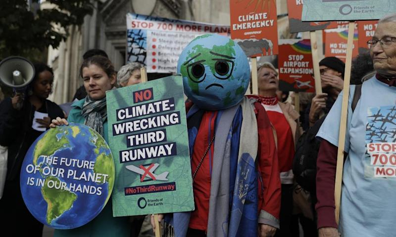 Campaigners against plans to expand Heathrow airport through the construction of a third runway protest outside the royal courts of justice on 17 October.