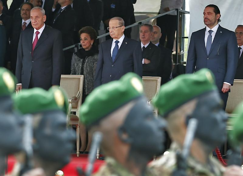 Lebanese Prime Minister Saad Hariri (R), President Michel Aoun (C) and House Speaker Nabih Berri attend a military parade to celebrate the 74th anniversary of Lebanon's independence in Beirut, on November 22, 2017 (AFP Photo/ANWAR AMRO)