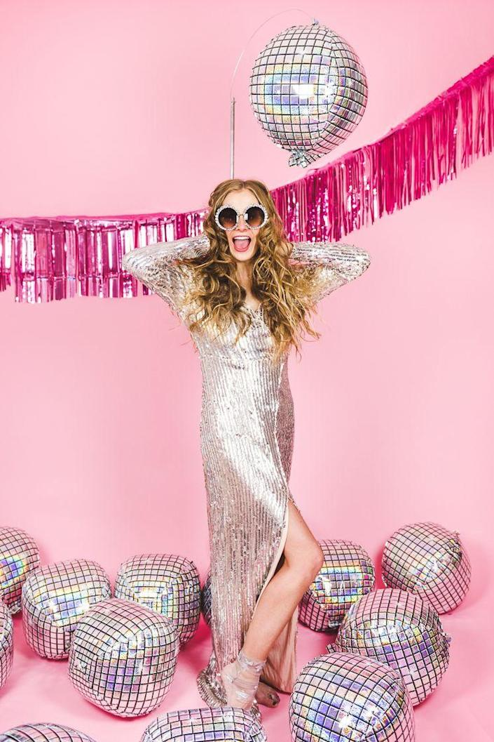 """<p>Hey dancing queen! Throw on your highest platforms and grooviest threads for a totally far out Halloween you won't soon forget. </p><p><strong>See more at <a href=""""https://thehousethatlarsbuilt.com/2019/10/disco-dream-girl-costume.html/"""" rel=""""nofollow noopener"""" target=""""_blank"""" data-ylk=""""slk:The House That Lars Built"""" class=""""link rapid-noclick-resp"""">The House That Lars Built</a>.</strong></p><p><a class=""""link rapid-noclick-resp"""" href=""""https://www.amazon.com/FEISEDY-Sparkling-Crystal-Sunglasses-Oversized/dp/B077GMJCV8/ref=sr_1_2_sspa?tag=syn-yahoo-20&ascsubtag=%5Bartid%7C2164.g.37115224%5Bsrc%7Cyahoo-us"""" rel=""""nofollow noopener"""" target=""""_blank"""" data-ylk=""""slk:SHOP SPARKLY SUNGLASSES"""">SHOP SPARKLY SUNGLASSES</a></p>"""