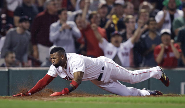 Boston Red Sox's Eduardo Nunez scores on a double by Rafael Devers during the seventh inning of a baseball game against the Los Angeles Angels at Fenway Park in Boston, Wednesday, June 27, 2018. (AP Photo/Charles Krupa)