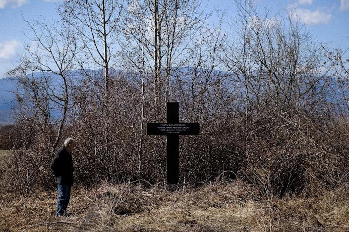Retired doctor Miroslav Stosic, 71, by the memorial to the civilians killed 20 years ago by NATO bombs in southern Surdulica (AFP Photo/Andrej ISAKOVIC)