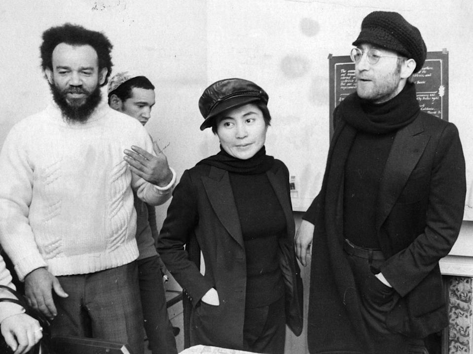 John Lennon and Yoko Ono with Black Power leader Michael X at his house in HollowayGetty