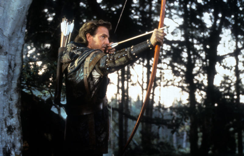Kevin Costner pulls a bow in a scene from the film 'Robin Hood: Prince Of Thieves', 1991. (Photo by Warner Brothers/Getty Images)