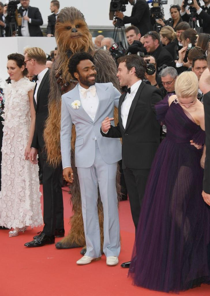 One of Urbinati's greatest hits: Donald Glover in a '70s-style Gucci prom tux with a fresh daisy on his lapel.