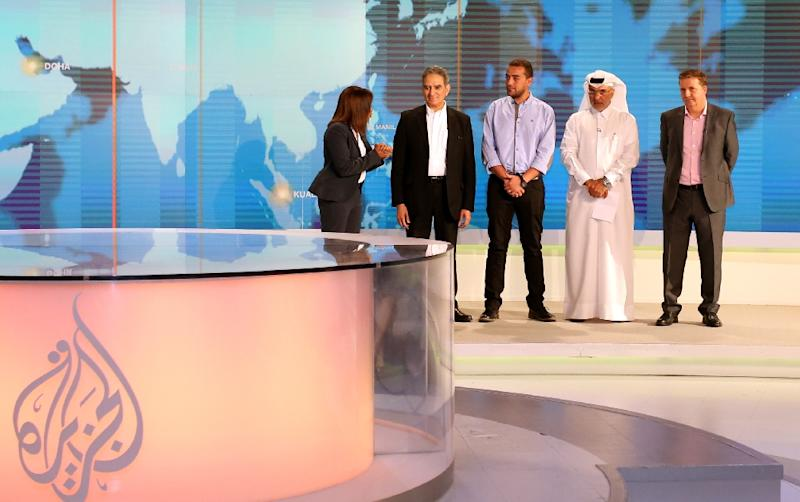 Executives at Qatar-based Al-Jazeera attend a welcome ceremony at the channel's newsroom in Doha on October 15, 2015 for their freed journalist Mohamed Fahmy after his release from Egyptian prisons (AFP Photo/Faisal al-Tamimi)