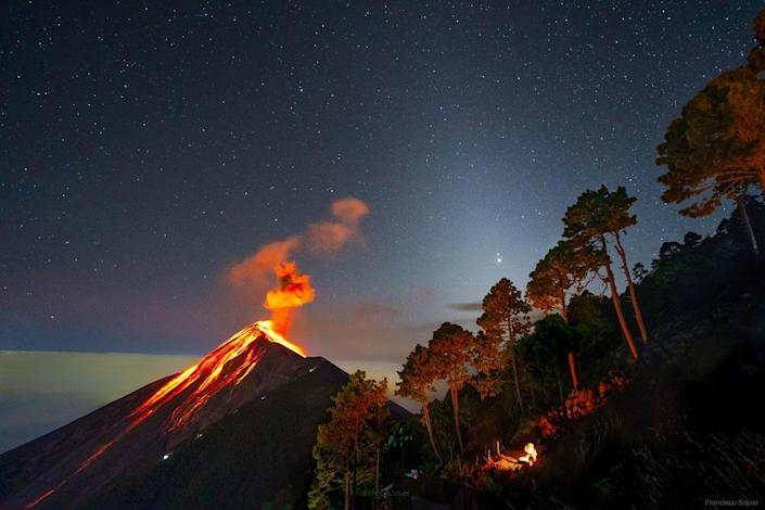Jupiter and Saturn are visible ahead of the great conjunction, over an erupting volcano in Guatemala. / Credit: Francisco Sojuel / NASA Astronomy Picture of the Day