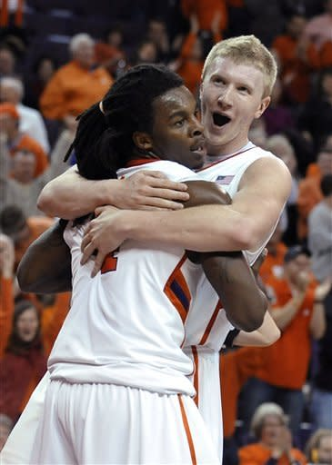 Clemson's Tanner Smith, right, celebrates with Rod Hall during the second half of an NCAA college basketball game against Virginia on Tuesday, Feb. 14, 2012, in Clemson, S.C. Clemson won 60-48. (AP Photo/Rainier Ehrhardt)