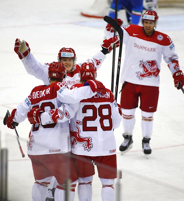 Denmark's players celebrate after Emil Kristensen, foreground right, scored against Italy's during the Group A preliminary round match at the Ice Hockey World Championship in Minsk, Belarus, Tuesday, May 13, 2014. (AP Photo/Sergei Grits)