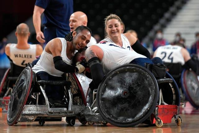 Britain's Ayaz Bhuta (left) and Stuart Robinson celebrate after winning the wheelchair rugby gold medal match against the U