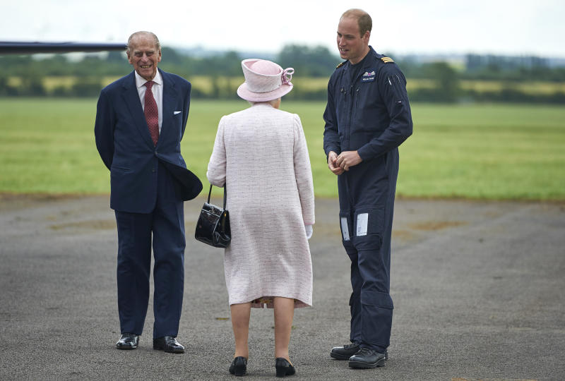 CAMBRIDGE, ENGLAND - JULY 13: Prince William, Duke of Cambridge gives Queen Elizabeth II and Prince Philip, Duke of Edinburgh a tour as she opens the new East Anglian Air Ambulance Base at Cambridge Airport on July 13, 2016 in Cambridge, England. (Photo by Niklas Halle'n - WPA Pool/Getty Images)