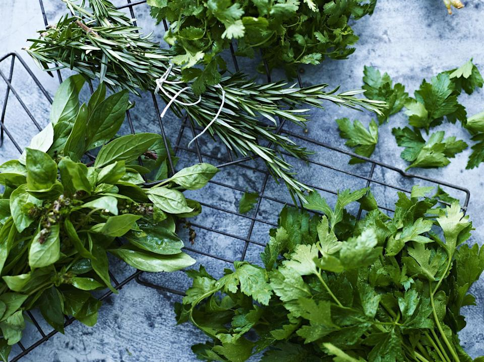 """<p>Fresh herbs can be pricey compared to dried ones so you want to be able to use every last leaf. There are two types of herbs — soft herbs and hard herbs. Soft herbs have a bendy, soft stem, like mint, cilantro or basil, which is one of the <a href=""""https://www.thedailymeal.com/healthy-eating/never-refrigerate-these-20-foods-slideshow?referrer=yahoo&category=beauty_food&include_utm=1&utm_medium=referral&utm_source=yahoo&utm_campaign=feed"""" rel=""""nofollow noopener"""" target=""""_blank"""" data-ylk=""""slk:foods you should never refrigerate"""" class=""""link rapid-noclick-resp"""">foods you should never refrigerate</a>. Hard herbs include rosemary, oregano and thyme, which have a tougher stem you can snap. You can tell they've gone bad for soft herbs if the leaves turn slimy, wilted and black. When hard herbs go bad, the leaves usually dry out and tend to change from green to yellow or brown.</p>"""