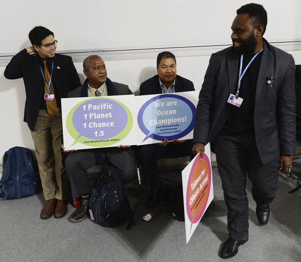 Climate activists from islands in the Pacific Ocean campaign for an ambitious global effort in fighting global warming at a U.N. climate conference in Katowice, Poland, Thursday, Dec. 13, 2018.(AP Photo/Czarek Sokolowski)