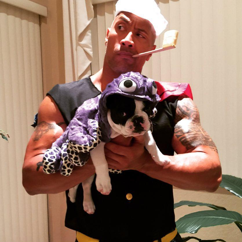 "<p>The Rock shared <a rel=""nofollow"" href=""https://www.instagram.com/p/_apnAhIh2t/"">a throwback pic</a> in 2015 that we're guessing his dog would rather not remember. ""#TBT To a very memorable Halloween… #PissedOffPopeye #MiserableHobbs,"" he wrote. (Photo: Instagram/The Rock) </p>"