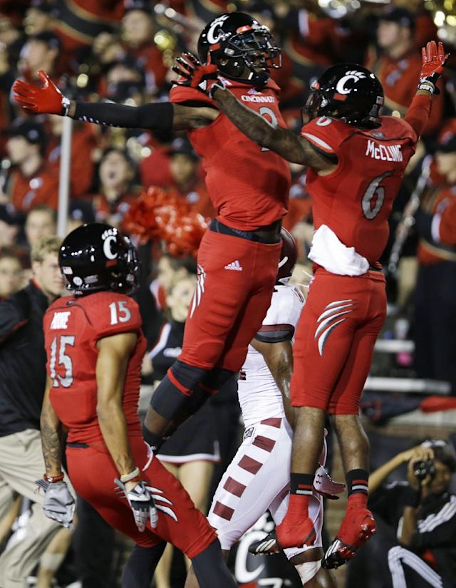 Cincinnati wide receiver Anthony McClung (6) celebrates with Mekale McKay (2) after McClung scored on a 25-yard pass reception in the first half of an NCAA college football game against Temple, Friday, Oct. 11, 2013, in Cincinnati. (AP Photo/Al Behrman)