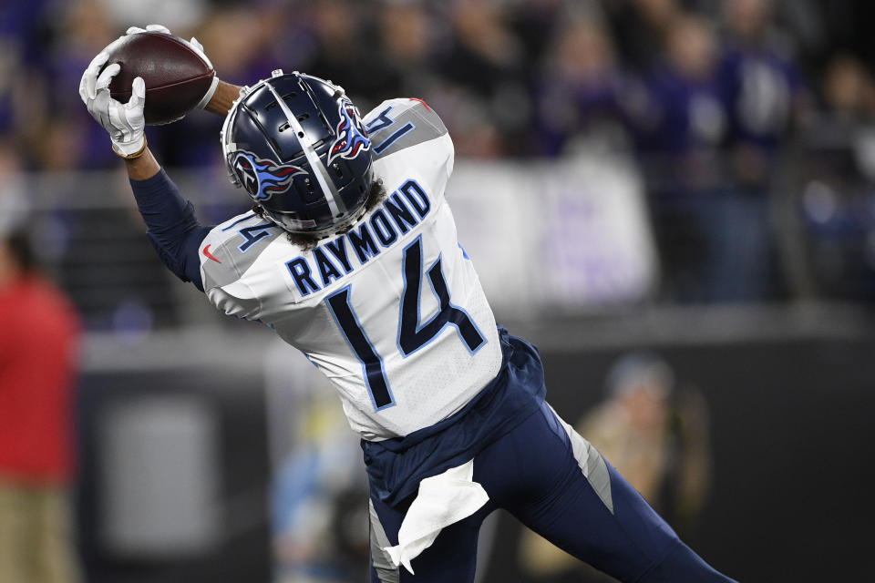 Tennessee Titans wide receiver Kalif Raymond (14) makes a touchdown catch against the Baltimore Ravens during the first half an NFL divisional playoff football game, Saturday, Jan. 11, 2020, in Baltimore. (AP Photo/Nick Wass)