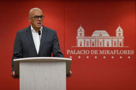 FILE PHOTO: Venezuela's Communications and Information Minister Jorge Rodriguez speaks during a news conference at Miraflores Palace in Caracas, Venezuela October 17, 2018. REUTERS/Carlos Garcia Rawlins
