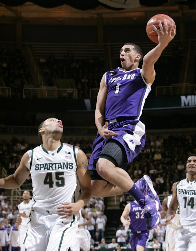 Portland Alec Wintering (2) puts up a layup against Michigan State's Denzel Valentine (45) during the first half of an NCAA college basketball game, Monday, Nov. 18, 2013, in East Lansing, Mich. (AP Photo/Al Goldis)