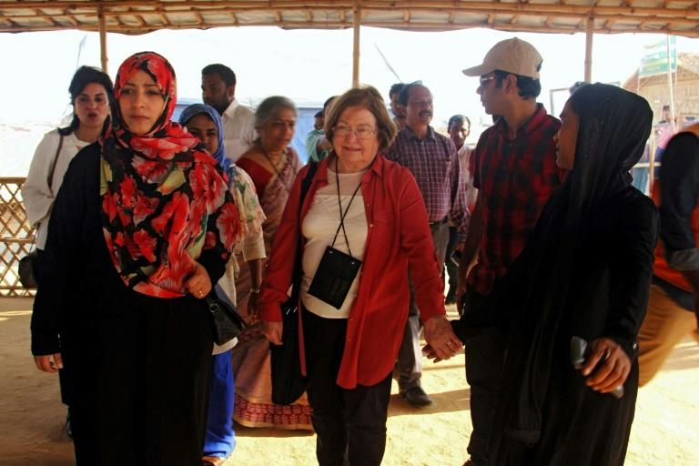 Nobel Peace Laureates Mairead Maguire (C) from Northern Ireland and Tawakkol Karman (L) from Yemen walk during their visit to Kutupalong refugee camp in Ukhia