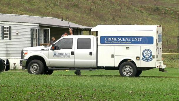 PHOTO: A truck investigating the crime scene is parked in front of the home in Lawrence County, Ohio. (WCHS)