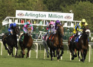 FILE - In this Aug. 9, 2008, file photo, Spirit One, right, from France, ridden by Ioritz Mendizabal, leads the Arlington Million at the Arlington Park race track in Arlington, Ill. Spirit One upset the morning-line favorite Archipenko. The racetrack is expected to close after the completion of racing on Sept. 25, with ownership taking bids for the future of the land. (AP Photo/Charles Rex Arbogast, File)