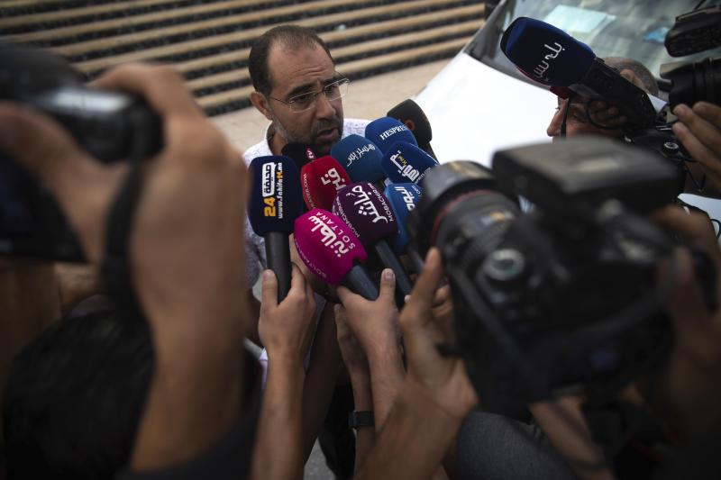 Suleyman Rissouni, uncle of journalist Hajar Rissouni and editor in chief of Akhbar Al-Youm daily newspaper, speaks to the media after the court delivered a one year prison sentence to his niece on accusations of her undergoing an illegal abortion, in Rabat, Morocco, Monday, Sept. 30, 2019. The 28-year old Moroccan journalist Hajar Raissouni was sentenced to one year in prison, Monday, while her fiancé also received a one-year sentence and the doctor accused of terminating the pregnancy was sentenced to two years in jail and suspended from practicing. (AP Photo/Mosa'ab Elshamy)