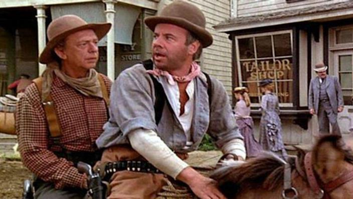<p>In the 1975 western comedy <em>The Apple Dumpling Gang</em>, three orphans strike it rich during the California Gold Rush, grabbing the attention of two holdup men played by Tim Conway and Don Knotts (Barney Fife from <em>The Andy Griffith Show</em>). The two bumbling baddies turn good by the end of the first movie, but their continued mishaps take center stage in the sequel.</p>