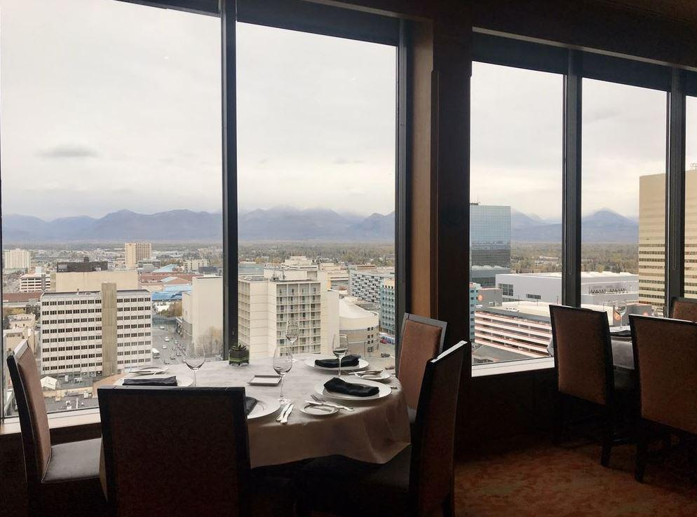 "<p>Located in the luxurious Hotel Captain Cook in Anchorage, Alaska, the AAA four-diamond Crow's Nest offers 360-degree views from the upper floors and an upscale menu of French and New American cuisine from chef Reuben Gerber. It's a restaurant with plenty of dark woods and a 10,000-bottle wine list. Menu items reflect the classy setting and include risotto, espresso-crusted rib-eye, bison filet and king crab, which makes the list of <a href=""https://www.thedailymeal.com/eat/must-try-food-all-50-states-gallery?referrer=yahoo&category=beauty_food&include_utm=1&utm_medium=referral&utm_source=yahoo&utm_campaign=feed"">the one food you need to eat in every state</a>.</p>"