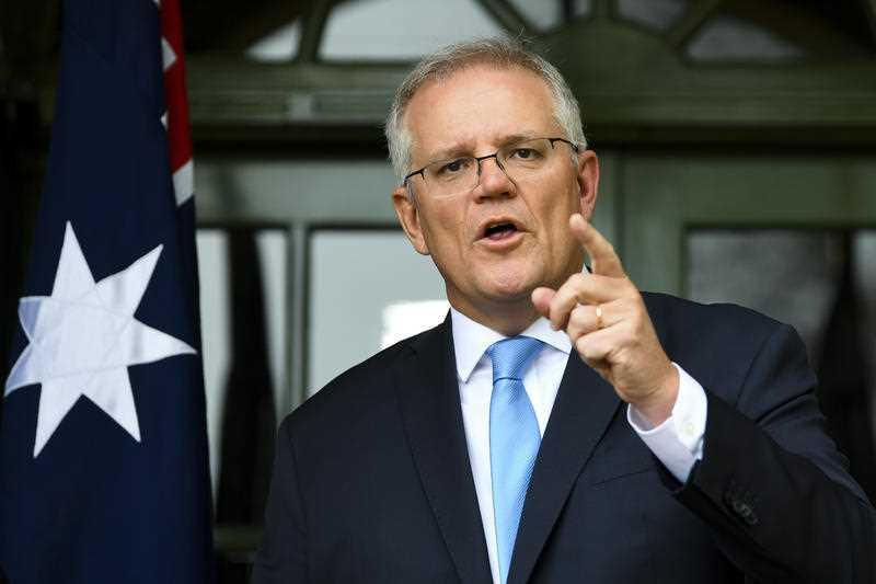 Australian Prime Minister Scott Morrison speaks to the media during a press conference at the Lodge in Canberra.