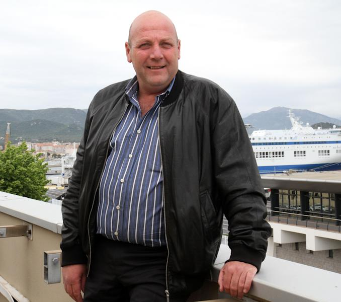 In this May 2011 photo, Jacques Nacer, chief of Corsica's chamber of commerce, poses in Ajaccio, Corsica island. France pledged Thursday Nov.15, 2012 to restore order in Corsica, a day after Nacer, also a prominent shopkeeper, was killed on a busy street on the Mediterranean island long troubled by violent separatists and organized crime. (AP Photo/Jean-Pierre Belzit)