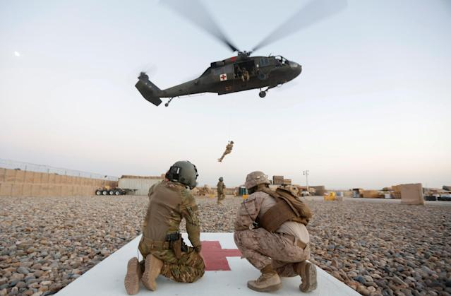 A U.S. Navy corpsman and U.S. soldier take part in a medevac exercise in Helmand province, Afghanistan, July 6, 2017. (Photo: Omar Sobhani/Reuters)