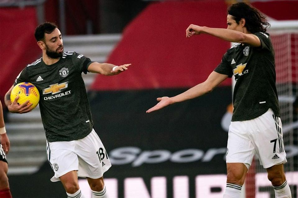 <p>Bruno Fernandes and Edinson Cavani</p> (Manchester United via Getty Imag)