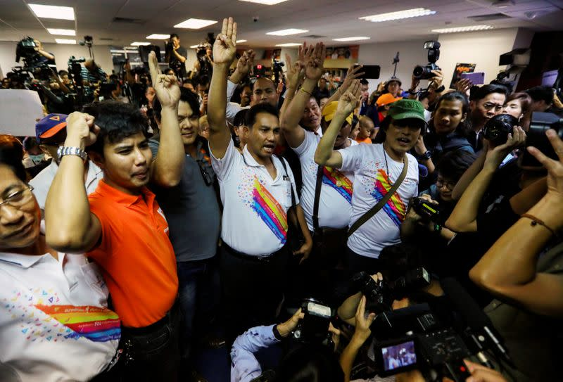 Supporters of Future Forward Party shout after Thailand's Constitutional Court ruled that key figures of the opposition Future Forward Party were not guilty of opposing the monarchy, at the party's headquarters in Bangkok