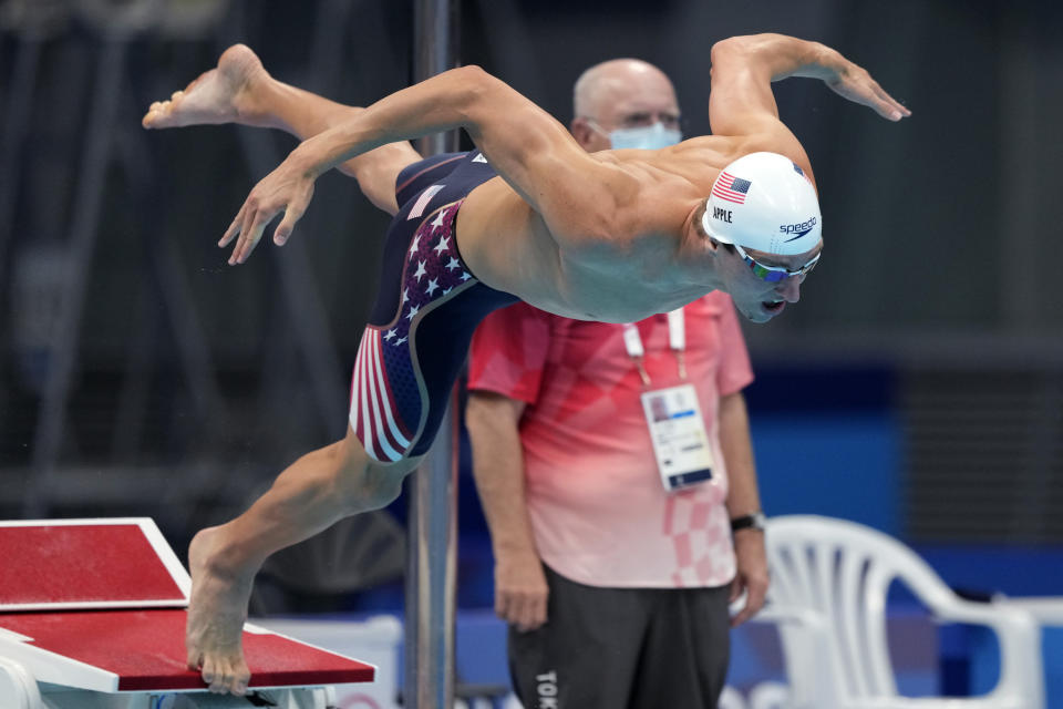 Zach Apple of the United States starts in his heat of the men's 100-meter freestyle at the 2020 Summer Olympics, Tuesday, July 27, 2021, in Tokyo, Japan. (AP Photo/Martin Meissner)