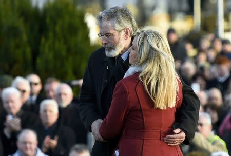 Sinn Fein's Michelle O'Neill and Gerry Adams join mourners at Martin McGuinness's funeral in Londonderry, Northern Ireland, March 23, 2017.          REUTERS/Clodagh Kilcoyne