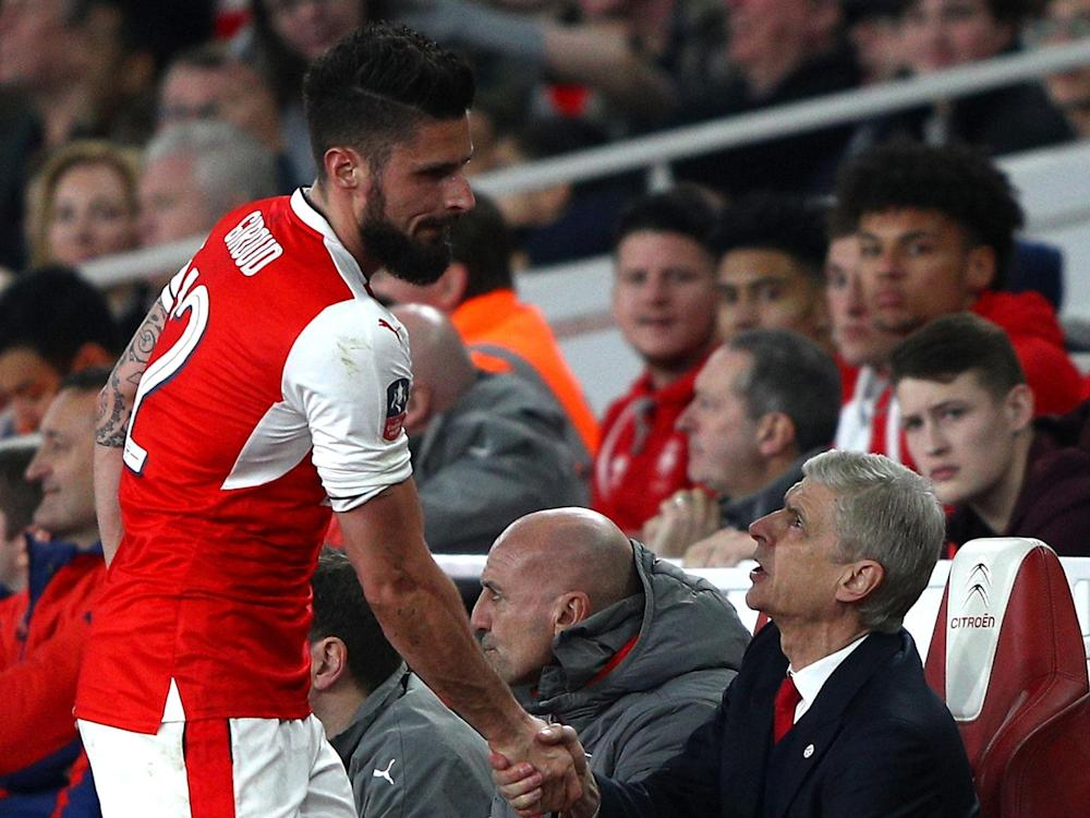 Olivier Giroud says the players want Arsene Wenger to stay at Arsenal: Getty