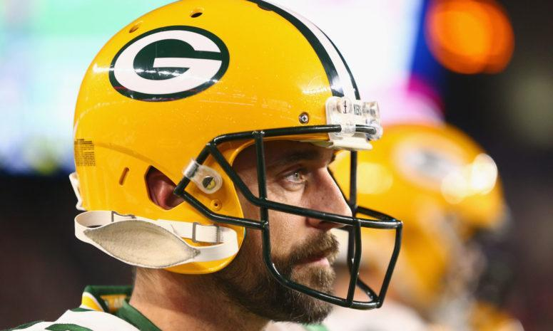 A closeup of Aaron Rodgers wearing a Green Bay Packers helmet.