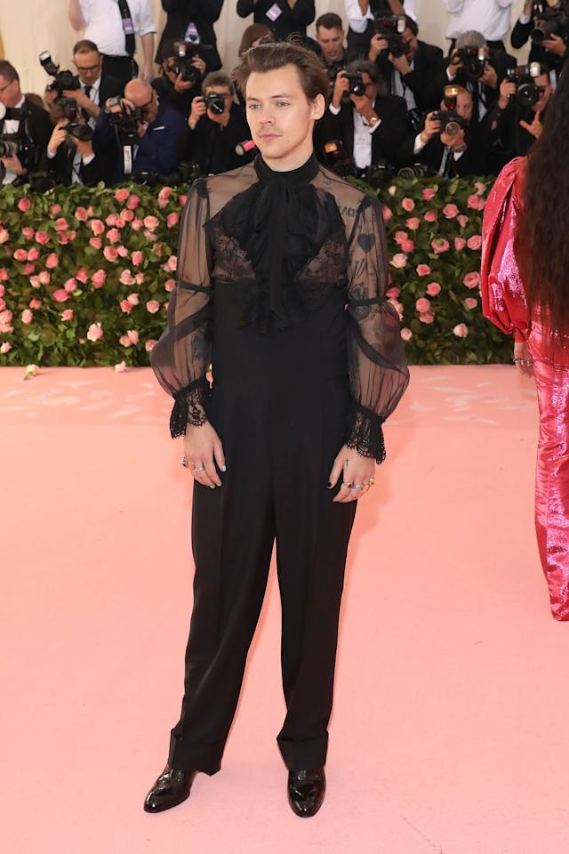 "<p>There's a lot to appreciate about <a href=""https://www.popsugar.com/celebrity/Harry-Styles-2019-Met-Gala-46116107"" class=""ga-track"" data-ga-category=""Related"" data-ga-label=""https://www.popsugar.com/celebrity/Harry-Styles-2019-Met-Gala-46116107"" data-ga-action=""In-Line Links"">Harry's custom Gucci Met Gala look</a>. The best parts are arguably the sheer black shirt with buttons down the back and his single drop pearl earring. </p>"