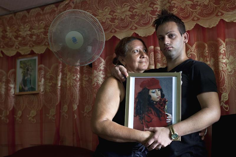 "Dayan Sanchez, 25, right, a gay transvestite artist known as ""Venus,"" holds a portrait of himself as he poses with his mother Anadelia Morales, 47, at his home in Havana, Cuba, Thursday, May 16, 2013. A week of drag shows, colorful marches and social and cultural events in Havana culminates Friday with celebrations of the International Day Against Homophobia. Gays were persecuted for decades after the 1959 Cuban Revolution, sometimes sent to grueling rural work camps along with others considered socially suspect by the Communist government. But there has been a gradual shift away from macho attitudes, and Fidel Castro himself has publicly regretted the mistreatment of people seen as different. (AP Photo/Ramon Espinosa)"