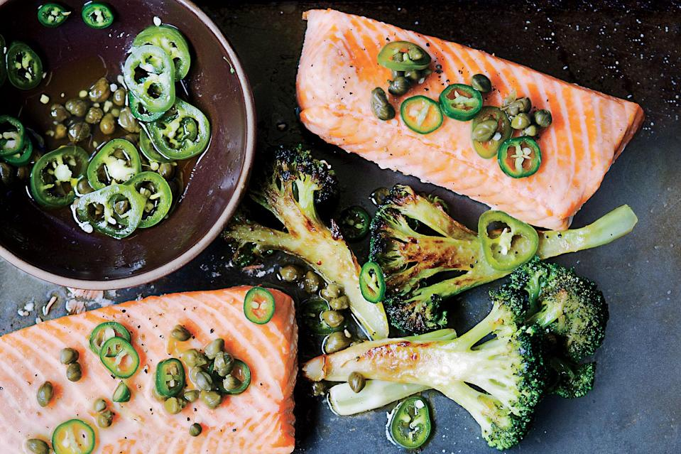 """Busy weeknights? <a href=""""https://www.epicurious.com/recipes-menus/easy-sheet-pan-dinners-recipes-chicken-salmon-shrimp-steak-fast-weeknight-meals-gallery?mbid=synd_yahoo_rss"""" rel=""""nofollow noopener"""" target=""""_blank"""" data-ylk=""""slk:Sheet pans"""" class=""""link rapid-noclick-resp"""">Sheet pans</a> to the rescue! For this easy salmon recipe, you'll give the broccoli a head start so it gets nicely browned by the time the salmon is perfectly cooked. <a href=""""https://www.epicurious.com/recipes/food/views/roast-salmon-and-broccoli-with-chile-caper-vinaigrette-51193100?mbid=synd_yahoo_rss"""" rel=""""nofollow noopener"""" target=""""_blank"""" data-ylk=""""slk:See recipe."""" class=""""link rapid-noclick-resp"""">See recipe.</a>"""
