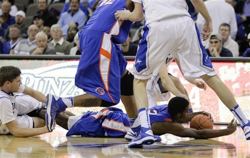 Boise State's Derrick Marks stretches for a loose ball next to Creighton's Grant Gibbs, left, in the first half of an NCAA college basketball game in Omaha, Neb., Wednesday, Nov. 28, 2012. (AP Photo/Nati Harnik)