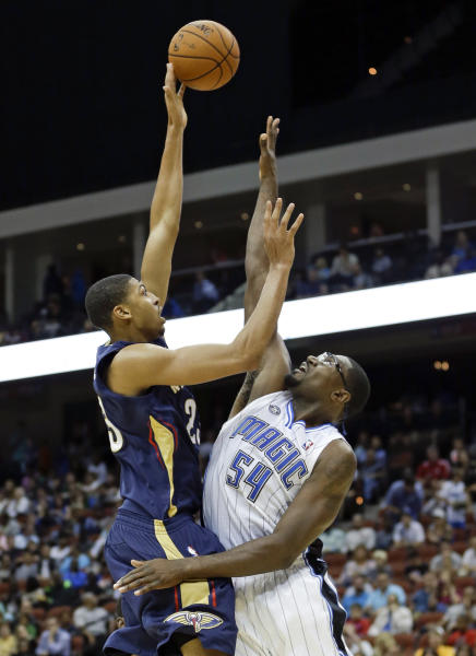 New Orleans Pelicans' Anthony Davis, left, shoots over Orlando Magic's Jason Maxiell (54) during the first half of an NBA preseason basketball game in Jacksonville, Fla., Wednesday, Oct. 9, 2013. (AP Photo/John Raoux)
