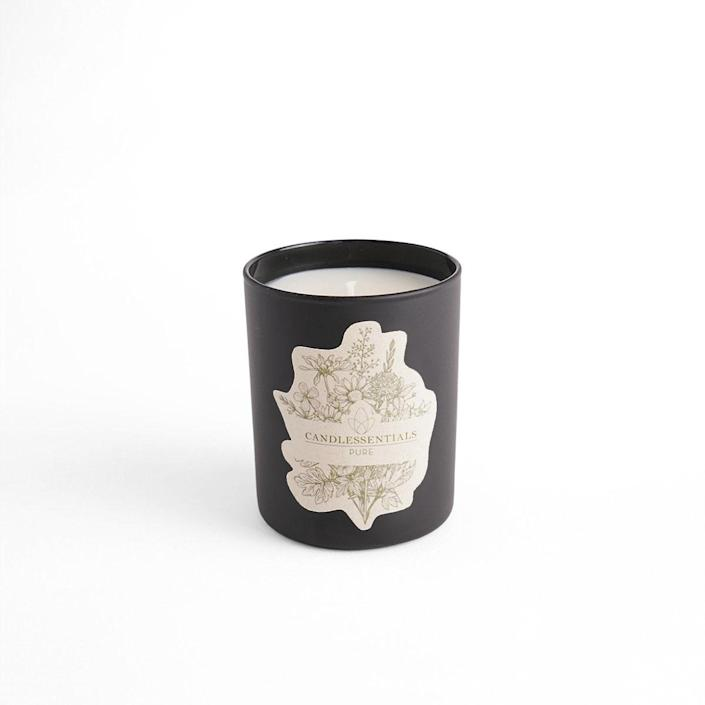 """This fresh-smelling <a href=""""https://www.architecturaldigest.com/story/best-candles-to-give-as-gifts?mbid=synd_yahoo_rss"""" rel=""""nofollow noopener"""" target=""""_blank"""" data-ylk=""""slk:candle"""" class=""""link rapid-noclick-resp"""">candle</a> from Candlessentials prominently features notes of patchouli and sandalwood to give Dad's space an earthy, woodsy vibe. $32, Candlessentials. <a href=""""https://www.candlessentials.com/collections/shop/products/pure"""" rel=""""nofollow noopener"""" target=""""_blank"""" data-ylk=""""slk:Get it now!"""" class=""""link rapid-noclick-resp"""">Get it now!</a>"""