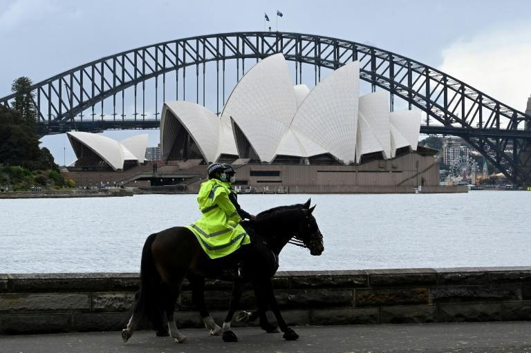 Police patrol in front of the Sydney Opera House on Monday (AFP/Saeed KHAN)