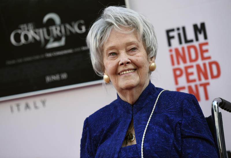 """FILE - In this June 7, 2016, file photo, paranormal investigator and film consultant Lorraine Warren poses at the premiere of the film """"The Conjuring 2"""" during the Los Angeles Film Festival at the TCL Chinese Theatre in Los Angeles. Warren, whose decades of ghost-hunting cases alongside her late husband were the inspiration for films such as """"The Conjuring"""" and """"The Amityville Horror,"""" died Thursday night, April 18, 2019, at her Connecticut home. She was 92.  (Photo by Chris Pizzello/Invision/AP, File)"""