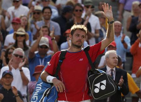 Wawrinka of Switzerland waves as he departs the court after being defeated by Djokovic of Serbia in their men's semi-final match at the U.S. Open tennis championships in New York