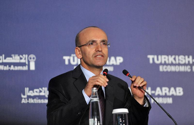 Turkish Finance Minister Mehmet Simsek delivers a speech during the Turkish Arab Economic Forum opening ceremony on April 4 2013 in Istambul (AFP Photo/Ozan Kose)