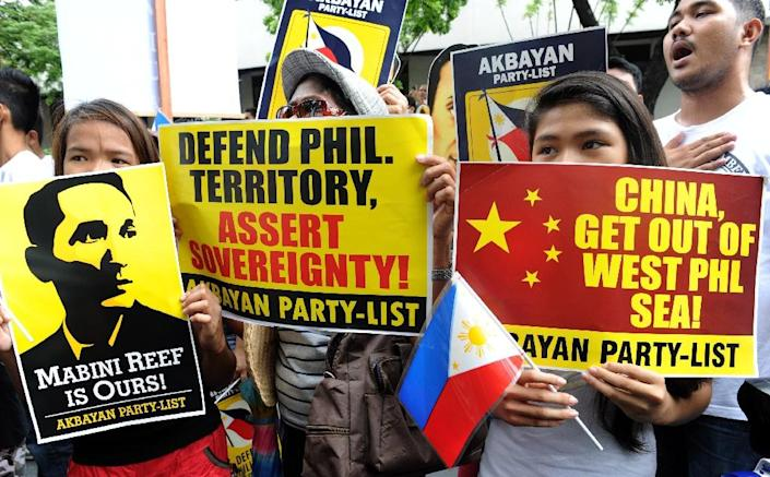 Filipino protesters display placards during a 2014 rally against Beijing's claim to disputed areas of the South China Sea (AFP Photo/Jay Directo)