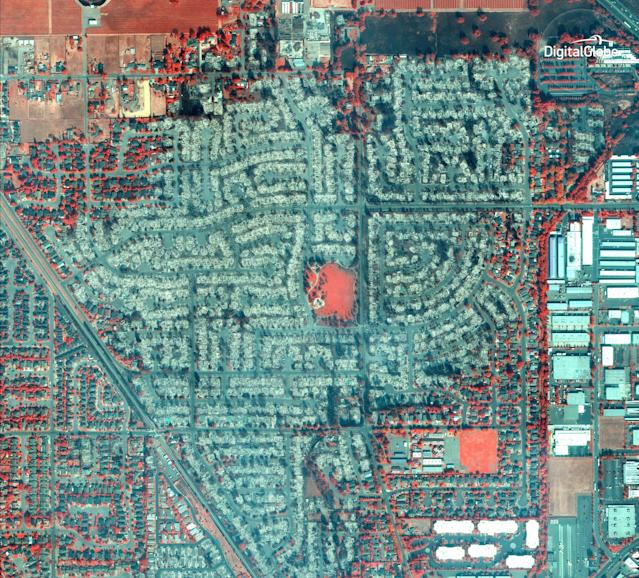 <p>This Wednesday, Oct. 11, 2017, satellite image using a Very Near Infrared (VNIR) provided by DigitalGlobe shows damage from the wildfire in Santa Rosa, Calif. VNIR imagery causes healthy vegetation to appear red and the burn scar from the wildfire to appear dark brown. Wildfires whipped by powerful winds swept through northern California, sending residents on a headlong race to safety through smoke and flames as homes burned. (Photo: Digital Globe via AP) </p>